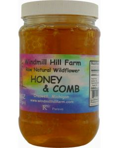 Honey & Comb - raw natural comb honey floating in a jar of wildflower honey